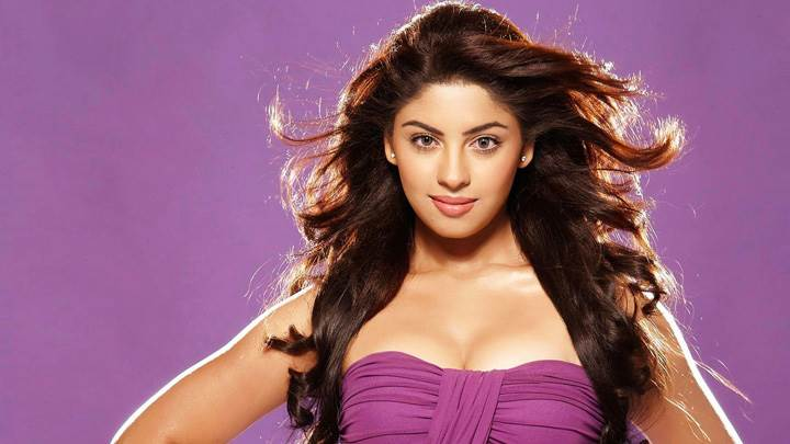 Richa Gangopadhyay Looking At Camera In Purple Dress N Purple Background